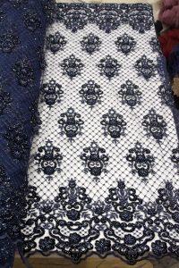 Tela de encaje de trabajo hecho a mano con cuentas de terciopelo azul marino