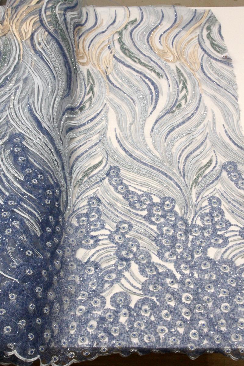 diseño de encaje hecho a mano de encaje con cuentas azules